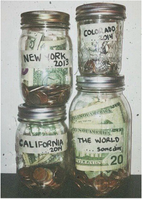 mason jars filled with money to save for travel adventures